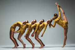 The group of modern ballet dancers. Dancing on gray background Royalty Free Stock Image