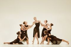 The group of modern ballet dancers. Dancing on gray studio background Royalty Free Stock Photography