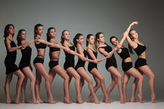 The group of modern ballet dancers. Posing on gray background Royalty Free Stock Photo