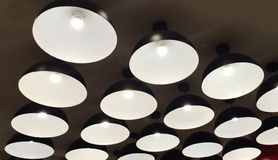 Group of Modern Black Metal Illuminated Lamps Hanging on The Ceiling Royalty Free Stock Photography