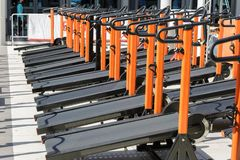 Group of Modern Orange Treadmill in Line in Fitness Center royalty free stock photo