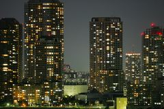 A group of modern skyscrapers in the city of Toyko in Japan at night royalty free stock photos