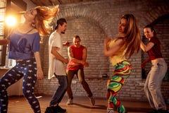 Group of modern street artist break dancers dancing in the studio. Sport, dancing and urban concept stock photography
