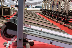 Group of Modern Treadmill with Steel Wheels in Line Stock Image
