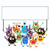 A group of monsters. Holding a placard Royalty Free Stock Images