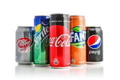 Group of most popular brands of soda drinks. Kyiv, Ukraine - September 5, 2018: Group of most popular brands of soda drinks in aluminum cans isolated on white stock photography
