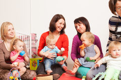Group of mothers with their babies. Group of mothers with their children gathered to talk Royalty Free Stock Photos