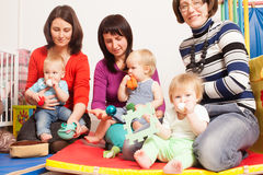 Group of mothers with their babies. Group of mothers with their children gathered to talk Royalty Free Stock Photo