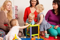 Group of mothers with their babies. Group of mothers with their children gathered to talk and for communication between kids Stock Photo