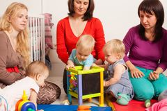 Group of mothers with their babies. Group of mothers with their children gathered to talk and for communication between kids Royalty Free Stock Images