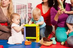 Group of mothers with their babies. Group of mothers with their children gathered to talk and for communication between kids Stock Image