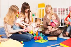 Group of mothers with their babies. Group of mothers with their children gathered to talk Stock Photos