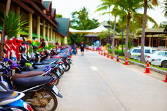 Group of motorbikes parked in row in public area. Group of motorbikes parked in a row in public area Royalty Free Stock Photo
