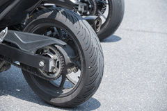 Group of motorbikes parked together Stock Images