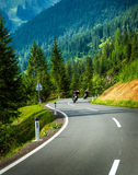 Group of motorcyclists in Alpine mountains Stock Photography