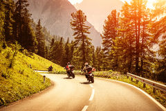 Group of motorcyclists on mountainous road royalty free stock images