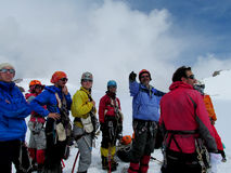 Group of mountain climbers discuss the route stock images