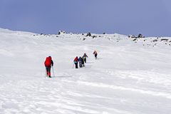 Group of mountaineers in the mountainous arctic landscape Royalty Free Stock Photography