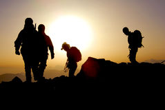 Group of mountaineers on the ridge of the mountain, at the sunrise Royalty Free Stock Image