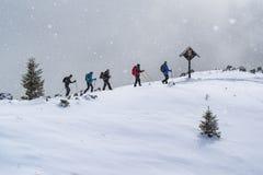 Group of Mountaineers walking. SLOVENJ GRADEC, SLOVENIA - FEBRUARY 18th 2017: Group of Mountaineers walking on the snowy ridge of the Urslja gora mountain in the Royalty Free Stock Photos
