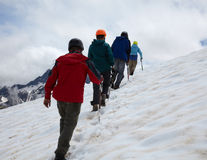 Group of mountaneers  in high mountains Stock Photo