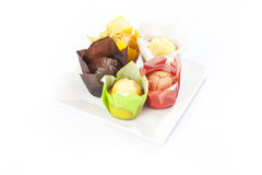 Group muffins in colored paper Stock Image