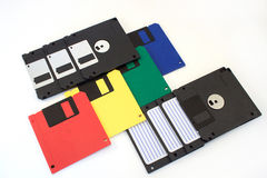 Group of multi-coloured floppy disks on the white background. Retro style Stock Photography