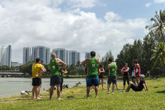 Group of multi-cultural men and women do warm up before sport event at Kallang river. Royalty Free Stock Photos