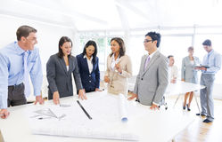 Group of Multi Ethnic Architects Planning for a New Project stock image