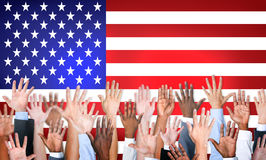 Group Of Multi-Ethnic Arms Outstretched With American Flag. As A Background Royalty Free Stock Photography