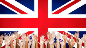 Group Of Multi-Ethnic Arms Outstretched With British Flag Stock Images