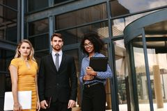 Group of multi-ethnic business colleagues. Portrait of confident business people standing together in front of office building. Group of multi-ethnic business royalty free stock photos