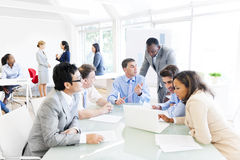 Group of Multi Ethnic Business People. Having a Meeting Royalty Free Stock Images