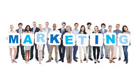 Group Of Multi-Ethnic Business People Holding Marketing Royalty Free Stock Photos