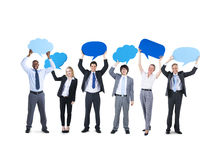 Group Multi Ethnic Cheerful Corporate Holding Speech Bubbles Concept royalty free stock photography