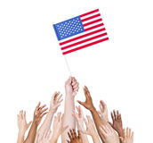 Group multi-ethnic people reaching holding flag Concept Stock Photo