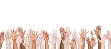 Group Of Multi-Ethnic People's Arms Outstretched In A White Back. Ground Stock Photos