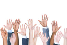 Group Of Multi-Ethnic People's Arms Outstretched In A White Background.  Royalty Free Stock Photography