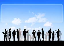 Group Of Multi-Ethnic People. Social Networking Outdoors And Empty Billboard Speech Bubble Above stock photography