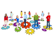 Group Of Multi-Ethnic People Standing On Gears Royalty Free Stock Images