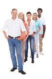 Group of multi-ethnic people standing in a row. Group Of Multi-racial People Standing In A Row On White Background Stock Images