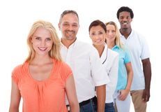 Group of multi-ethnic people standing in a row. Group Of Multi-racial People Standing In A Row On White Background stock photography