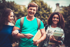 Group of multi ethnic students walking in a city Stock Photos