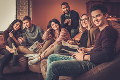 Group of multi ethnic young students preparing for exams in home interior Royalty Free Stock Photos