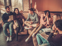 Group of multi ethnic young students preparing for exams in home interior Stock Image