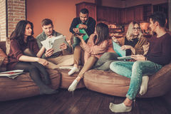 Group of multi ethnic young students preparing for exams in home interior Stock Photography