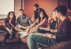 Group of multi ethnic young students preparing for exams in home interior Royalty Free Stock Photo