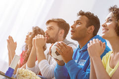 Group of multi national football fans cheering Stock Images