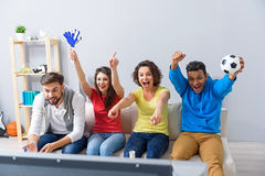 Group of multi national football fans cheering Royalty Free Stock Images