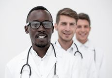 Group of multi-racial doctors standing in a row royalty free stock image
